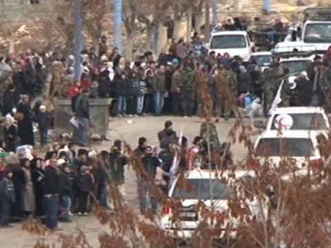 Raw: Aid Convoys Arrive At Syrian Village