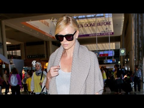 Charlize Theron Looks Down When Asked About Breakup At LAX