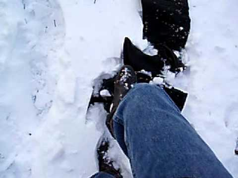 Thigh high Black leather boots in snow