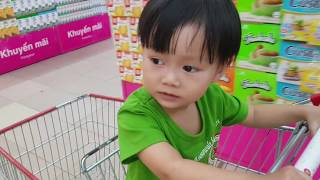 Baby doing grocery shopping at supermarket