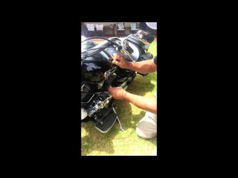 Removing motorcycle emblems from fuel tank
