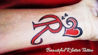 Beautiful R Letter Tattoo with love Heart