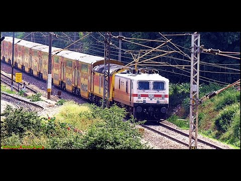 Wap 7 With Double Decker Or Twin Smoking Alco With A Train Descending Down A Track.. Confused... video