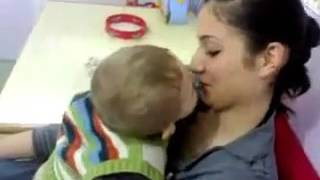 small boy tries to kiss his mother  very funny and cute