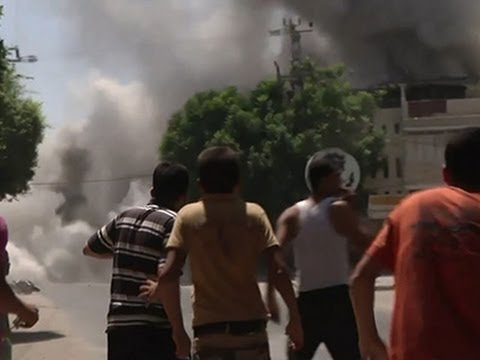 Raw: Israeli Airstrikes Hit Building in Gaza