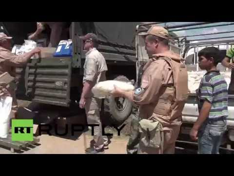 Syria: Russian troops deliver humanitarian aid to Al-Alamein