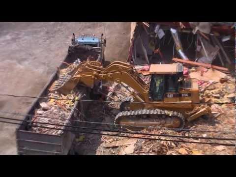 Track Loader Fills Dump Truck at Demolition Site