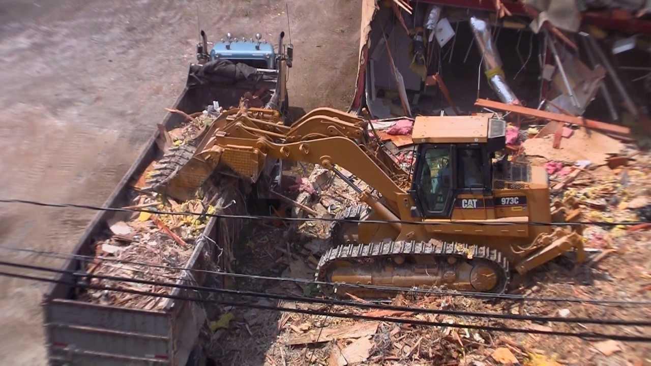 Track Loader Fills Dump Truck at Demolition Site - YouTube