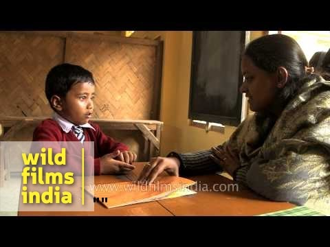 Indian boy at school with his teacher, in Assam