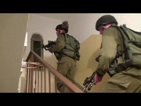 Israel re-arrests over 50 Palestinians and approves new settlements in east Jerusalem