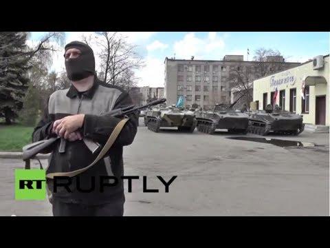 Ukraine: Armed men guard military vehicles in Slavyansk