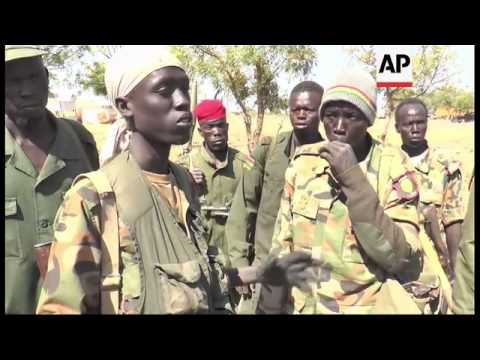 South Sudan soldiers celebrate after taking control of key town