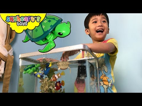 Toddler fishing his toys in A REAL AQUARIUM! Robo Alive Fish and Turtle toys for kids