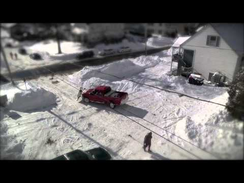Snowplow cleaning up after Winter Storm Juno hits Maine