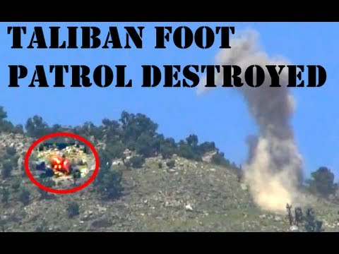 ARTILLERY EXPLODING ON TALIBAN HILLSIDE POSITIONS IN AFGHANISTAN