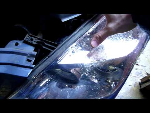 How To Change Headlight On A Kia Sedona