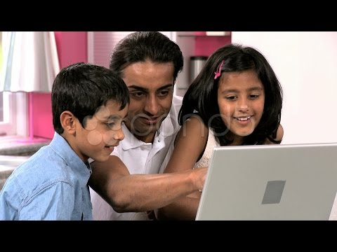 Young Asian Father and Children Using Laptop In Kitchen. Stock Footage