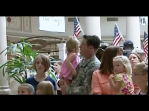 Singing Flash Mob Overwhelms Soldier