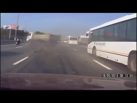 Truck Nearly Crashes into Motorbike