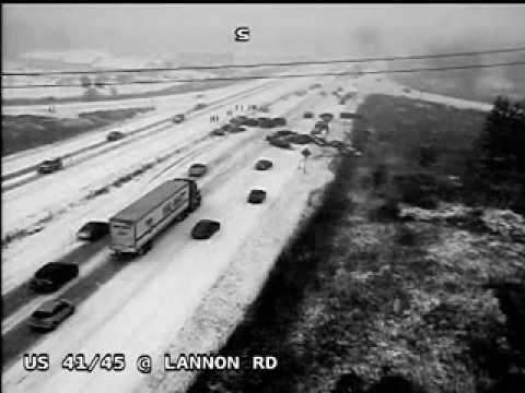 There's really no better way to demonstrate why you should slow down during a snowstorm than this. A traffic camera from the Wisconsin Department of Transpor...
