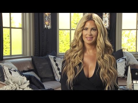 Kim Zolciak Says Waist Trainers Have Her 'Sweating Profusely,' Fires Back at 'Haters'