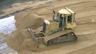 Cat D4H LGP spreading sand part 1