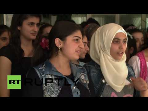 Syria: Russian forces deliver humanitarian aid to Damascus orphan school
