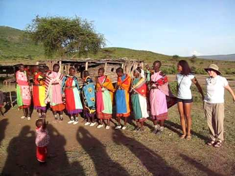 vanetta and maryanne dancing with masai women