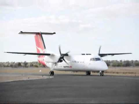 A Qantas QantasLink Sunstate Airlines Dash-8-Q300 VH-TQH touching down and taxiing to its gate at Moranbah Airport. CQ Plane Spotting (http://cqplanespotting...