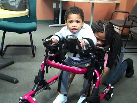 Wheelchairs 4 kids lazarus tries his new gait trainer mp4 youtube