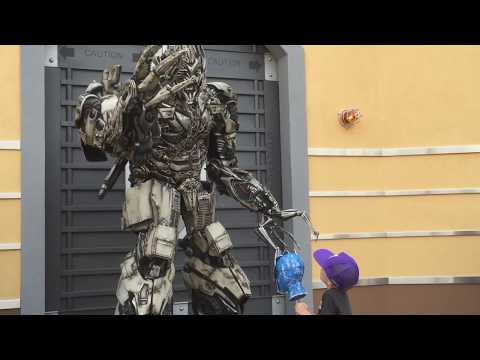 Kid gives Megatron Optimus Prime's head - happy Megatron