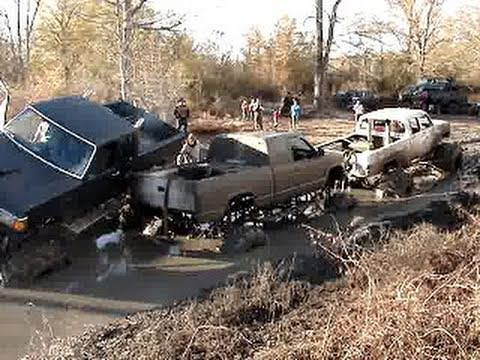 MUD TRUCKS TANGLED UP!! BIG BLOCK 4x4 CHEVY, GMC & FORD - STUCK MUDDIN!