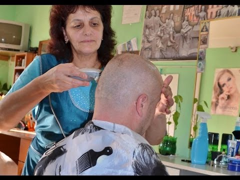 Close clipper shave at female barber