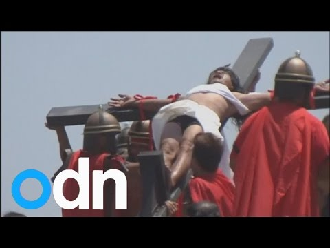 Graphic crucifixion video: Filipino Christians nail themselves to crosses on Good Friday