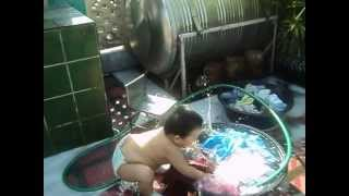 baby washing clothes
