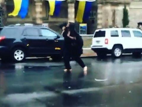 Watch: Barefoot, veiled man shouts