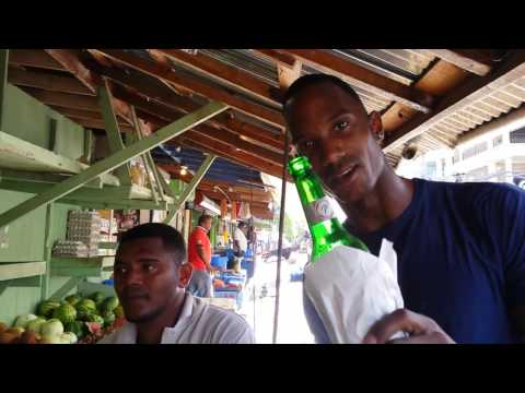 Man Drinks Beer On The Job While Attending To Customers At A Fruit Market!