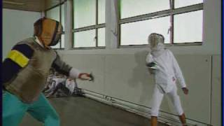 Willi and Somkhit begin fencing.wmv