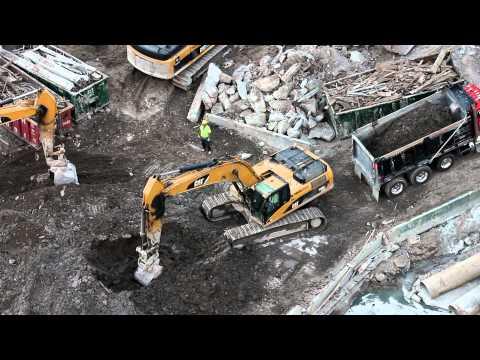Cat 330DL Excavator loading dump truck
