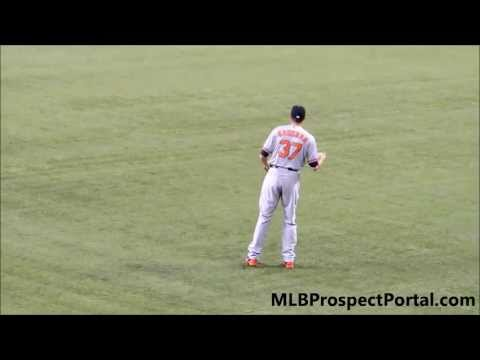 Orioles RHP Kevin Gausman long tossing in the outfield before his Major League debut