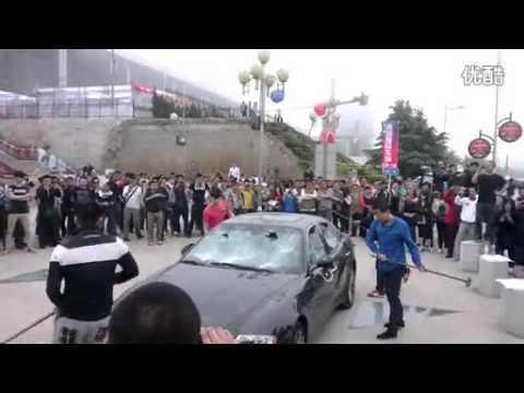 Chinese car owner smashes his own Maserati to spite car dealership