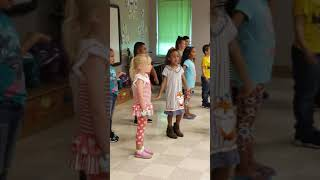 My daughter's kindergarten songs and dances (shes the one with the orange bow)