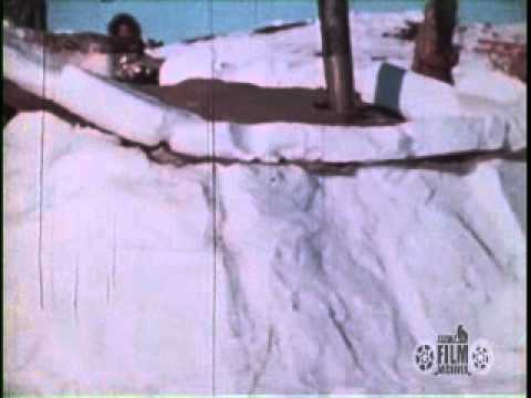 34 second silent film clip of a traditional winter underground house. This film sequence is an excerpt of AAF-90 from the North Slope Borough Collection held...