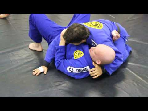 Knee on belly to 2 x 4 choke Image 1