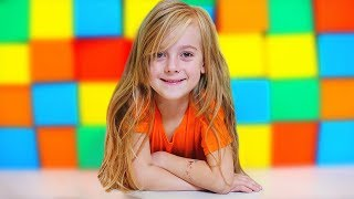 Girl and Mom Play with colored cubes
