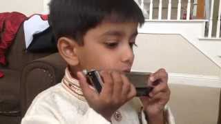 4 year old Christopher Pottoore rendition of Mana Ho Tum on Harmonica
