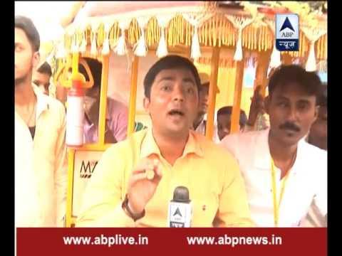 PM Narendra Modi takes a ride on e-rickshaw in Varanasi after distributing them