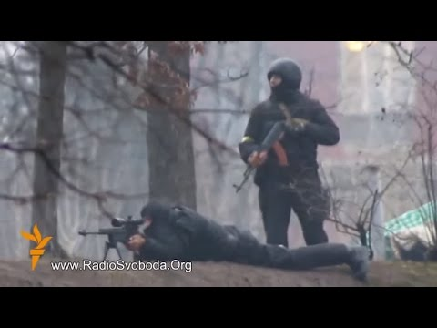 Euromaidan - Riot police sniper shoots at protesters in Kiev Ukraine