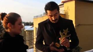 Kenan İmirzalıoğlu receiving his Award Of The Most Admired Cinema Actor of 2012