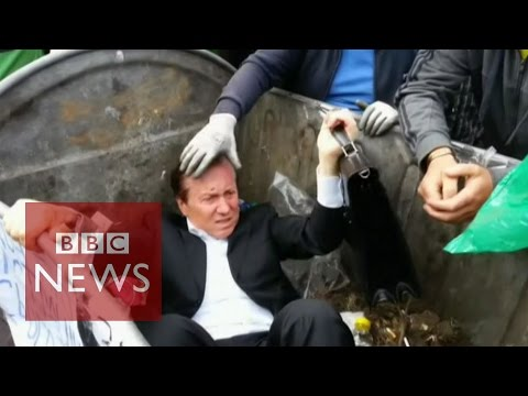 Ukrainian politician 'thrown' into a rubbish bin by angry mob